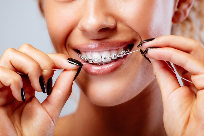 flossing-tips-with-braces-best-orthodontist-west-corona-ca